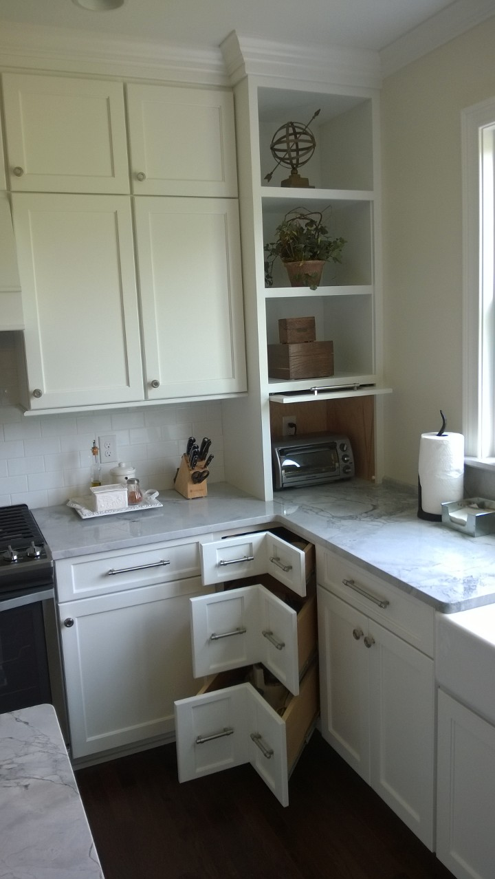 Corner of kitchen with 90 degree drawers and flipper door in the countertop cabinet. & Corner of kitchen with 90 degree drawers and flipper door in the ...