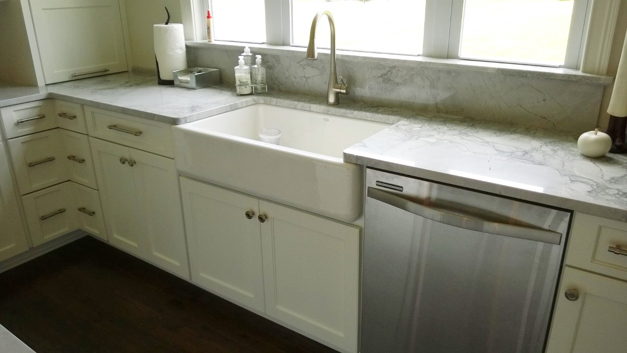 Beautiful Kohler farmhouse sink, and well done quartzite countertops by Z Stone of South Bend IN.